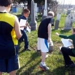 Students examine stones in the Big Run Cemetery.