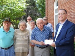 Franklin Township Historical Society members accept a check from Indiana Landmarks representative, Mark Dollaske, on August 20, 2015.